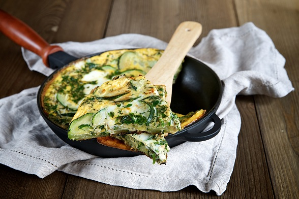 Frittata with onions, zucchini and spinach. Selective focus