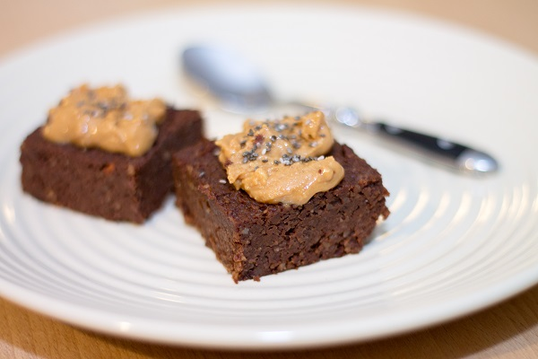 Fresh Homemade Vegan Chocolate Brownies topped with peanut butte